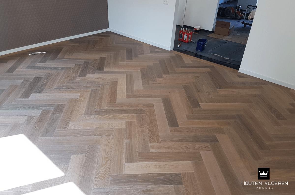 Visgraatvloer leggen juni houten vloeren paleis